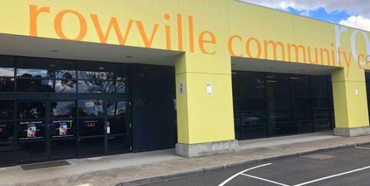 Image shows exterior of Rowville Community Centre building and entrance