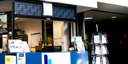 Image shows Rowville Neighbourhood House customer service counter