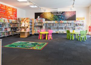 Interior image of childrens section of Doveton Library showing colourful furniture and shelving with books