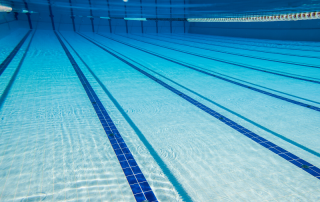 Image of swimming pool showing lap lanes and shimmering blue water