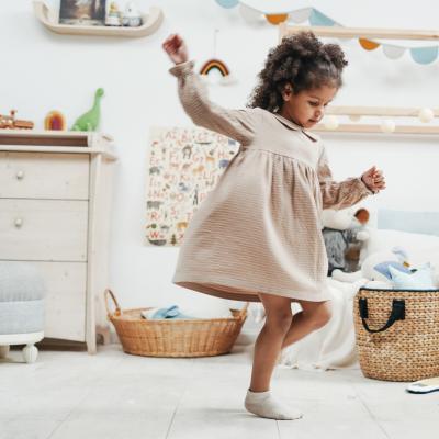 Small girl dancing at home