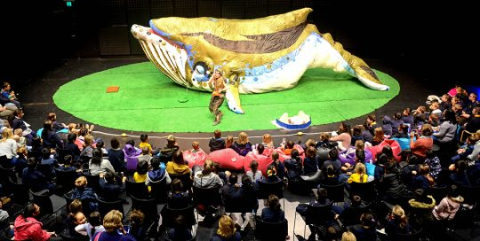 Image shows performance on stage in Bunjil Place Studio with giant whale on stage and audience watching