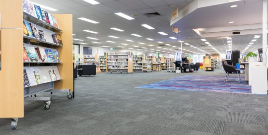 Interior image of library showing display shelves with books