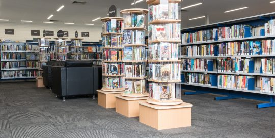 Interior of Endeavour Hills Library showing shelving with books