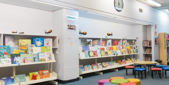 Children's section in the Knox Library showing shelving , books and furniture