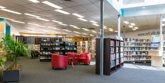 Interior of Rowville Library showing shelving, books and furniture