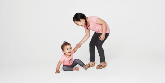 Two small children playing and laughing