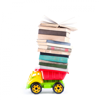 Toy dumper truck carrying pile of books