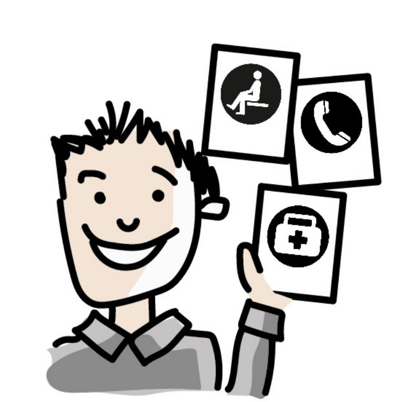 Cartoon drawing of young male holding visual communication cards