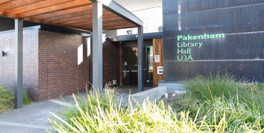 Main entrance to Pakenham library and community hall with covered walkway and glass entry doors and