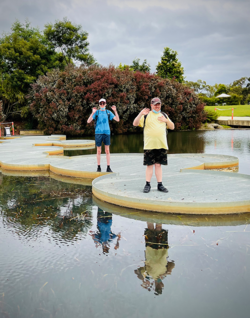 Two yound adult Wallara clients picutred outdoors at Cranbourne Royal Botanic Gardens