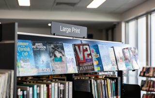 Large print book collection and signage at Kangaroo Flat Library