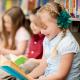 Children sitting on floor of public library reading