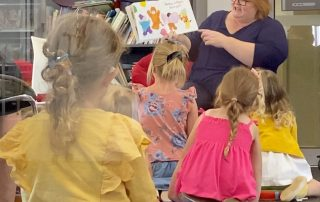 Library staff member reading a picture story book to children at Kangaroo Flat Library