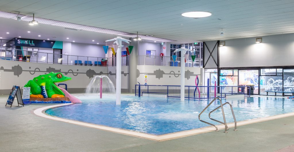Knox Leisureworks indoor toddler pool with frog water slide and active water features spraying water